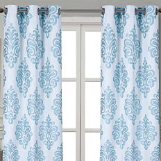 A blue and white printed set of curtains. Shop window treatments.