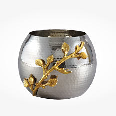 A silver- and gold-toned candle holder. Shop decorative accents.