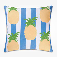 A blue and white stripe pillows with a pineapple print. Shop throw pillows.