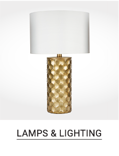 A gold lamp with a white shade. Shop lamps and lighting.