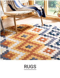 A blue and orange patterned area rug. Shop rugs.