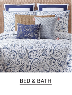 A blue and white paisley comforter set with matching pillows. Shop bed and bath.