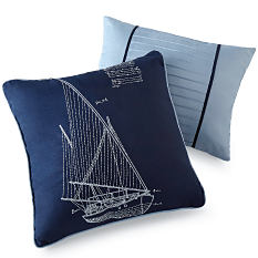 A navy & white throw pillow with a sailboat graphic on it. A powder blue throw pillow with 2 navy stripes. Shop throw pillows.