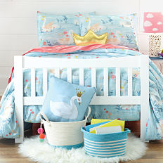 A child's bed and a printed comforter. Shop kids' bed and bath.
