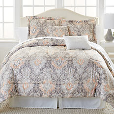 A bed with a printed comforter and pillows to match. Shop bed-in-a-bag sets.