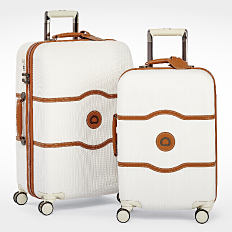 2 rolling suitcases. Shop luggage.
