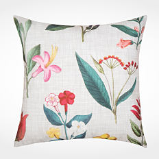 A white pillow with a colorful floral print. Shop home decor.