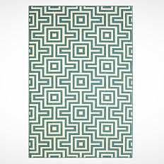 A green and white print rug. Shop rugs.