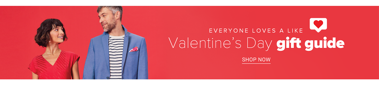 A woman in a red dress and a man in a black and white striped shirt under a blue blazer with a red pocket square. Everyone loves a like. Valentine's day gift guide. Shop now.