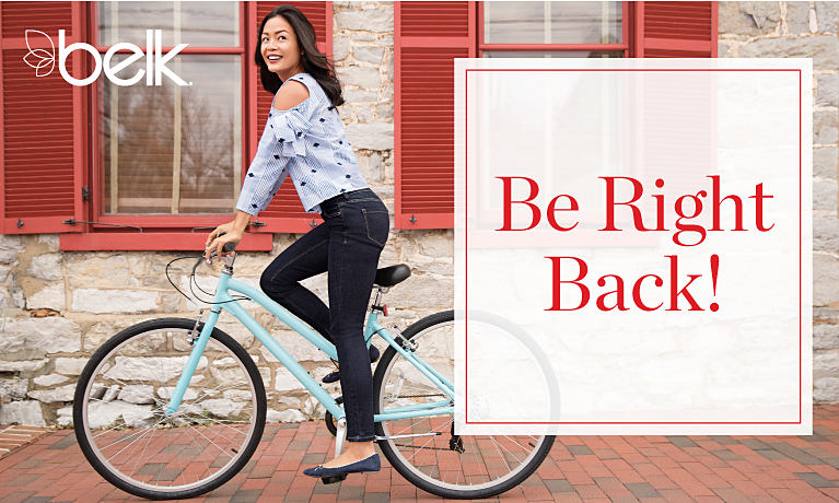 A smiling woman riding a teal bicycle. Be Right Back!!