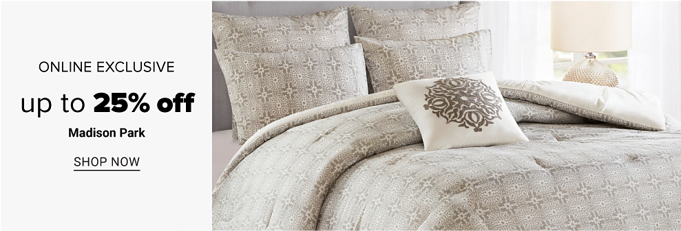 A bed made with a white and grey comforter set, with matching pillows. Online exclusive. Up to 25% off Madison Park. Shop now.