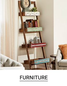 A shelf with a variety of books and home decor. Shop furniture