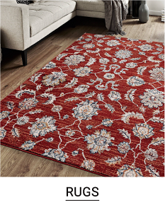 A red area rug with a gray floral print. Shop rugs.
