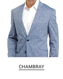A man in a chambray sport coat and white dress shirt Shop chambray.