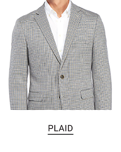 A man in a black and white plaid sport coat and white dress shirt. Shop plaid.
