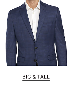 A man in a navy sport coat and a white dress shirt. Shop big and tall.