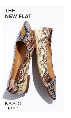 A pair of snakeskin print pointed toe flats. The new flat. Kaari Blue.