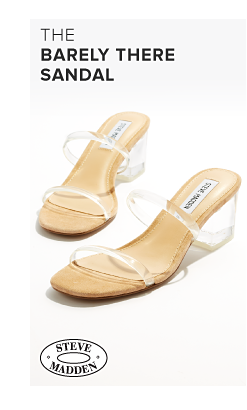 A pair of strappy high heel beige sandals. The barely there sandal. Nine West.