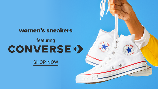 A pair of white Converse All Star sneakers featuring a red stripe detail. Women's sneakers featuring Converse. Shop now.