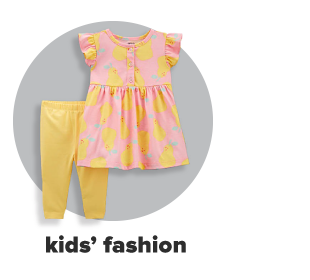 A little girl's two-piece set featuring a pink blouse with a yellow, lemon print and yellow leggings. Kids' fashion.