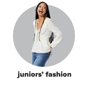 A young woman wearing blue jeans and an ivory blouse. Juniors' fashion.