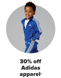A boy in a bright blue Adidas track suit, the brand's iconic white stripe running down the sleeves and legs. 30% off Adidas for the family.