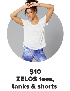 A woman in a white tee and blue and white tie dye leggings. $10 Zelos tees, tanks and shorts for the family.