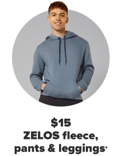 A man in a green hoodie with his hands in the hoodie's pockets. $15 Zelos fleece, pants, leggings and bras for the family.