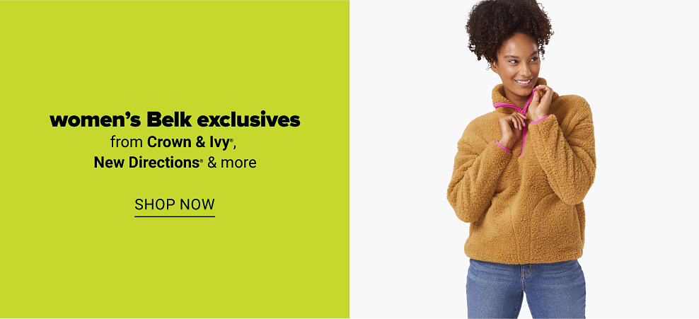 A woman in a tan sherpa pullover with hot pink stitching and jeans. Women's Belk exclusives from Crown and Ivy, New Directions and more. Shop now.