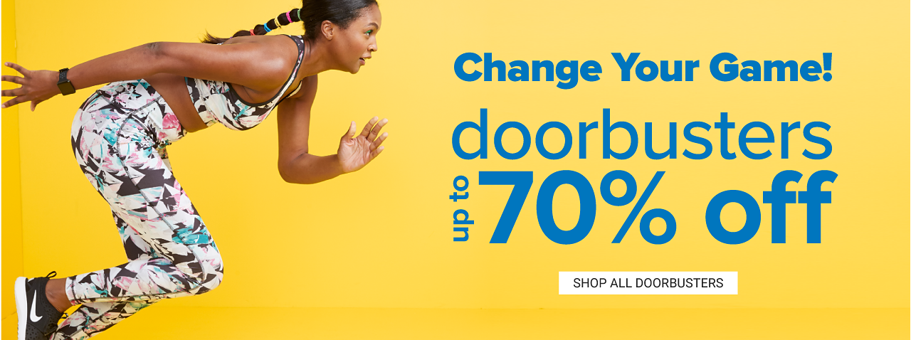 A woman wearing a multi colored print sports bra, matching yoga pants & black sneakers. Change Your Game. Doorbusters. Up to 70% off. Shop all doorbusters.