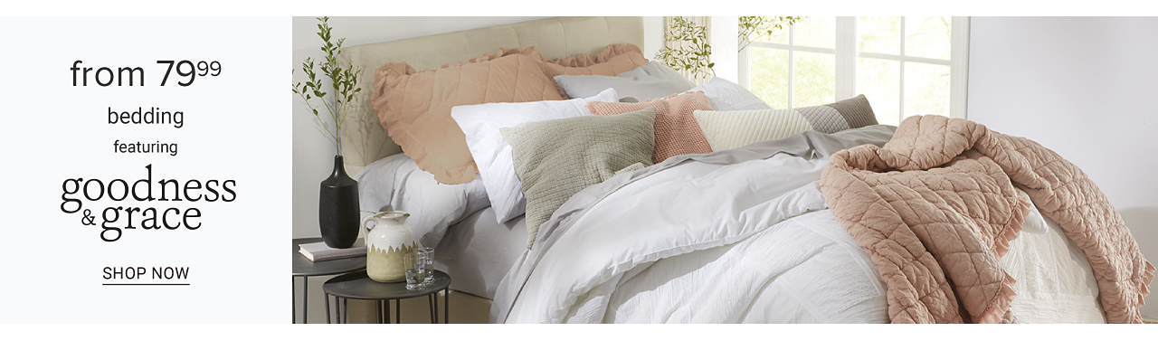 A bed made with a white comforter & an assortment of different colored pillows. From $79.99 bedding featuring Goodness & Grace. Shop now.