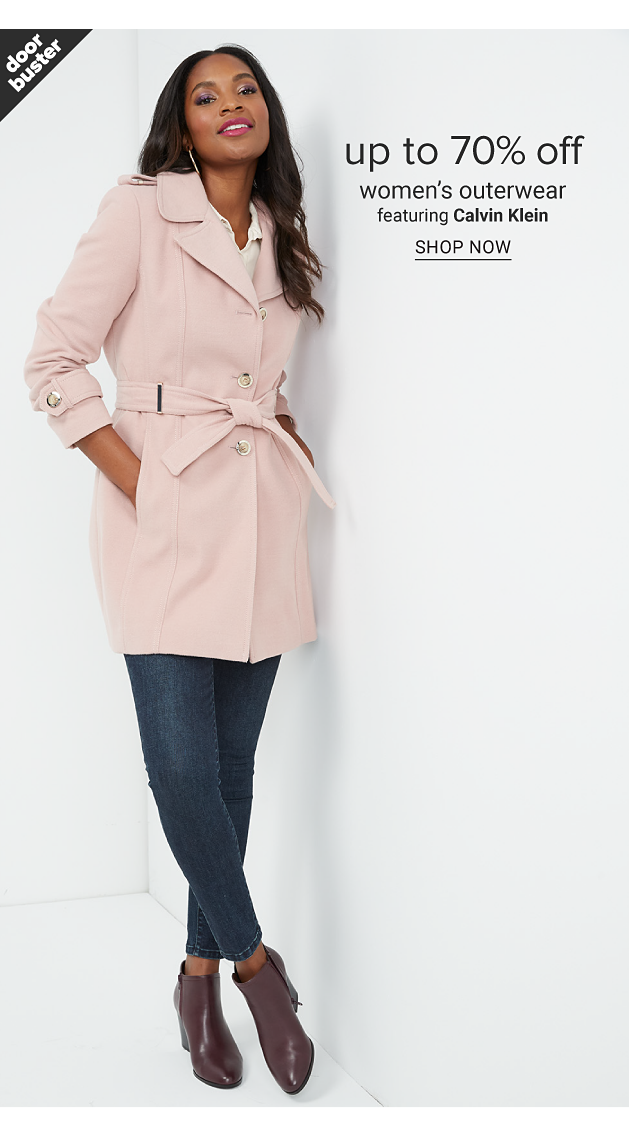 A woman wearing a light pink overcoat over a white top, black pants & black leather booties. Doorbuster. Up to 70% off women's outerwear featuring Calvin Klein. Shop now.