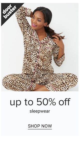 A woman wearing leopard print pajamas. Doorbuster. Up to 50% off sleepwear. Shop now.
