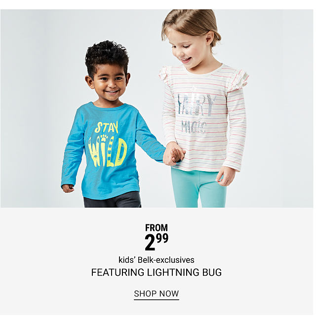 A boy wearing a teal & yellow Stay Wild long sleeved graphic tee & blue jeans standing next to a girl wearing a white long sleeved top with multi colored horizontal stripes & a silver Fairy Magic front graphic & teal pants. From $2.99 kids Belk exclusives featuring Lightning Bug. Shop now.