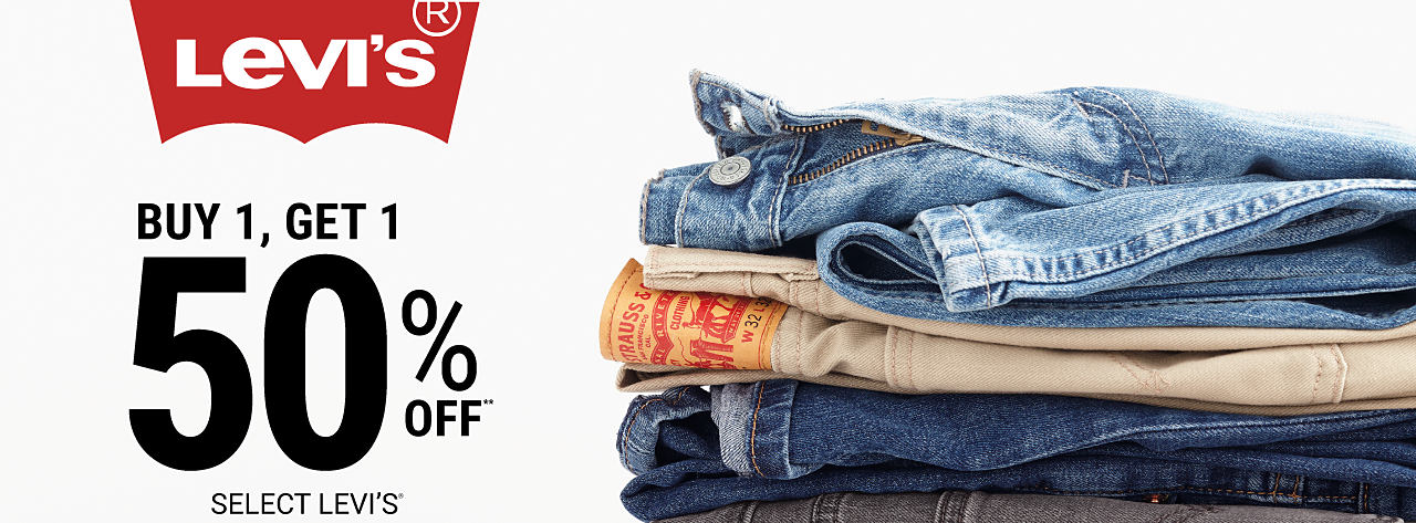 A stack of folded jeans in a variety of colors & styles. Buy 1, Get 1 50% off select Levi's. Free or discounted items must be of equal or lesser value.