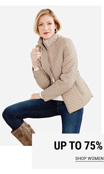 Up to 75% off outerwear for the family. A woman wearing a beige quilted coat over a white top, blue jeans & brown leather boots. Shop women.