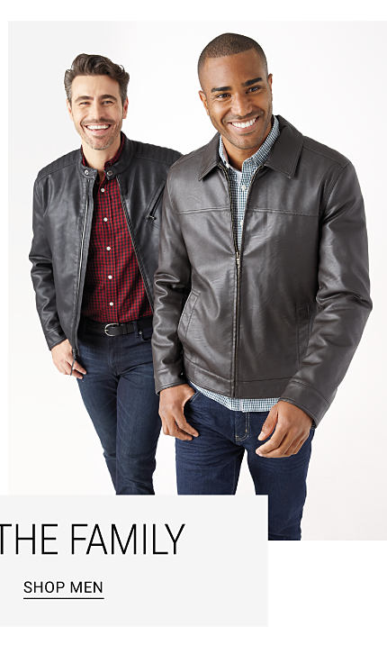 A man wearing a black leather jacket over a red & black check button front shirt & blue jeans standing next to a man wearing a black leather jacket over a button front shirt & blue jeans. Shop men.