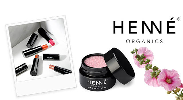 A Polaroid picture of an assortment of Henne Organics lipsticks in a variety of colors.  A jar of Henne Organics lip exfoliator next to some pink flowers. Introducing a splash of eco-luxury into the everyday: minimalistic approach that replaces standard lip care products with something extraordinary. Swedish inspired. American made. Shop Henne.