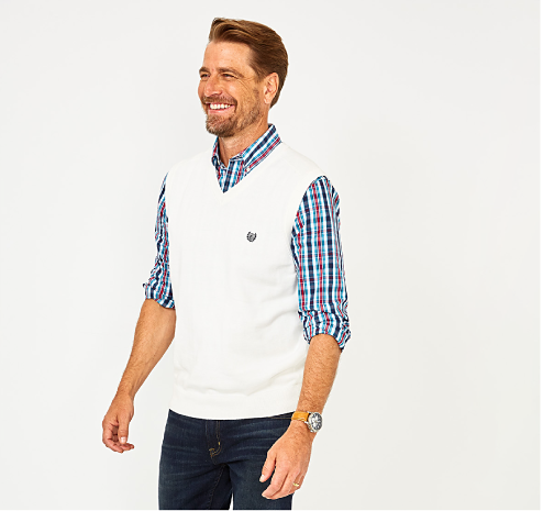 A stack of folded dress shirts in a variety of colors and prints. Doorbuster. buy 1, get 1 free select men's pants, denim, shirts & more.