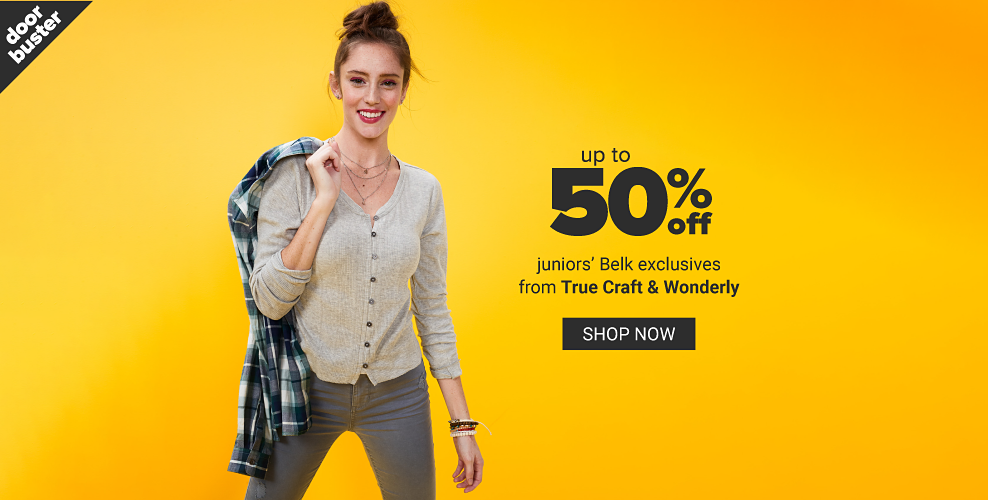 A young woman in a light gray button front sweater and jeans holding a plaid shirt over her shoulder. Doorbuster. Up to 50% off juniors' Belk exclusives from True Craft and Wonderly. Shop now.