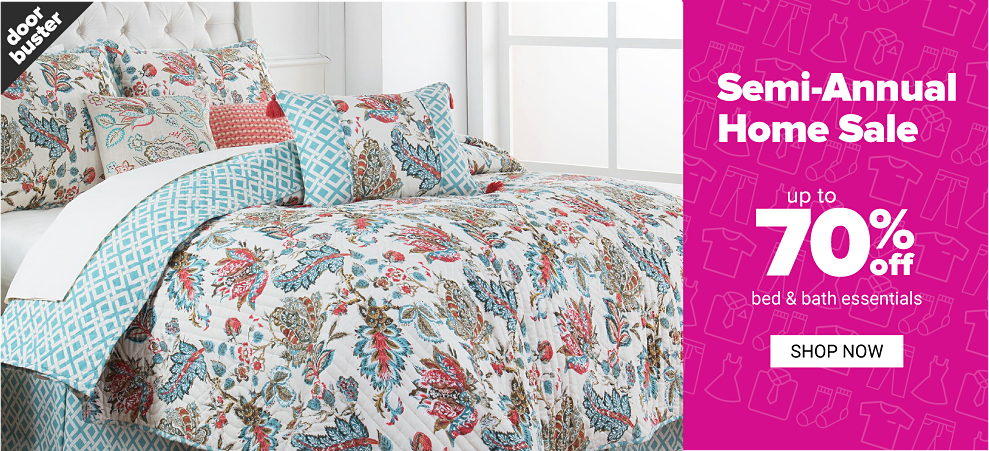 A bed made with a reversible quilt with a multi colored floral print on one side & a teal & white patterned print on the other side & matching pillows. Doorbuster. Semi Annual Home Sale. Uop to 70% off bed & bath essentials. Shop now.
