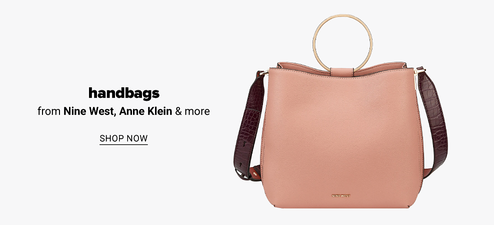 A light pink leather Nine West handbag with brown leather strap, and a large gold ring at the opening. Handbags from Nine West, Anne Klein and more. Shop now.