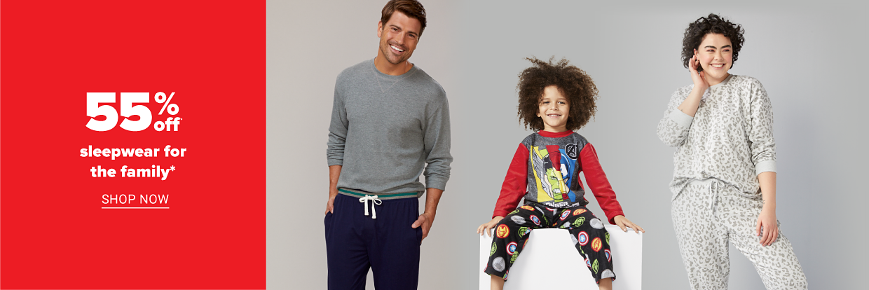A young girl wearing a two-piece leopard print pajama set in beige. A little boy wearing a two-piece Marvel Avengers pajama set. A man wearing a gray pajama top and navy blue pajama pants. 55% off sleepwear for the family. Shop women. Shop juniors. Shop men. Shop kids.