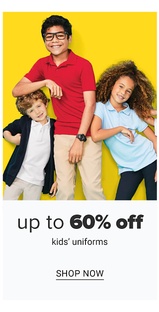 A boy wearing a black jacket over a white polo & light gray pants standing next to a boy wearing glasses, a red polo & beige pants & a girl wearing a light blue polo & navy pants. Up to 60% off kids uniforms. Shop now.