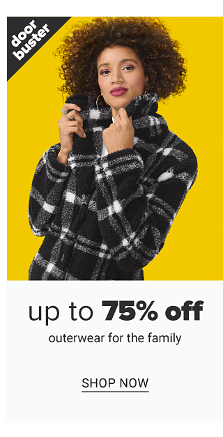 A woman wearing a black & white plaid winter coat. Doorbuster. Up to 75% off outerwear for the family. Shop now.