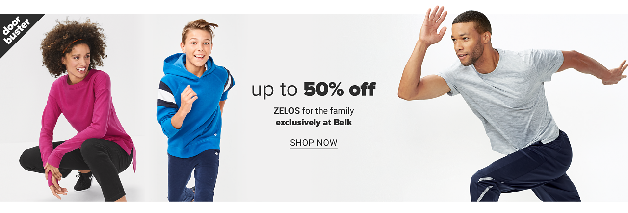 A woman wearing a fuchsia long sleeved top, black pants & black sneakers. A boy wearing a blue hoodie with navy & white horizontal stripes on the sleeves & navy pants. A man wearing a light gray T shirt & navy pants. Doorbuster. Up to 50% off Zelos for the family. Exclusively at Belk. Shop now.