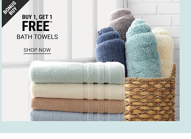 A stack of folded bath towels in a varety of pastel colors next to an assortment of rolled up bath towels in a basket. Bonus Buy. Buy 1, Get 1 Free bath towels. Free or discounted items must be of equal or lesser value. Shop now.