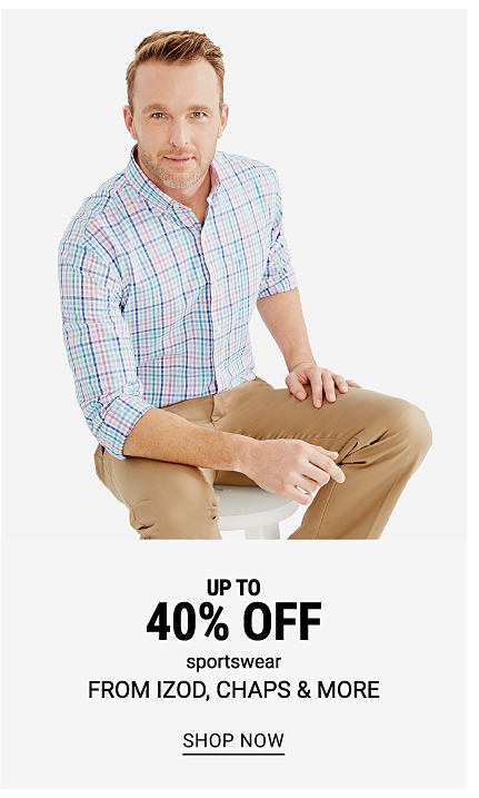 A man wearing a multi colored check long sleeved button front shirt & beige pants. Up to 40% off sportswear from Izod, Chaps & more. Shop now.