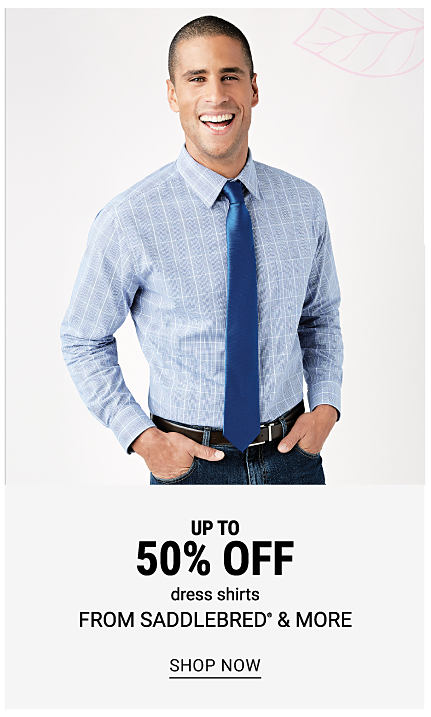 A man wearing a light blue & white patterned print, a blue tie & blue jeans. Buy 1, Get 1 50% off dress shirts from Saddlebred & more. Free or discounted items must be of equal or lesser value. Shop now.