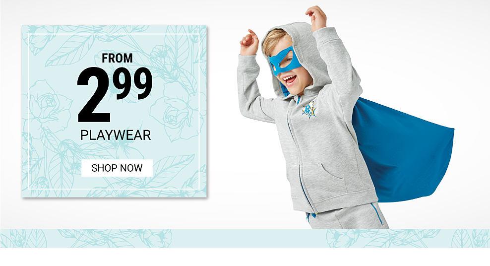 A Boy Wearing A Gray Hoodie, Gray Pants, A Blue Cape U0026 A Blue